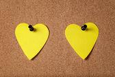 Heart shape sticky notes on cork board — Foto de Stock