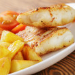 Roasted codfish fillet with vegetables — Stock Photo #39854109