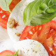 Caprese salad made on cutting board — Stock Photo #40297763