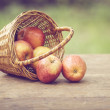 Gala apples in the basket on old table — Stock Photo #40800491