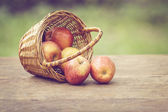 Gala apples in the basket on old table — Stock Photo