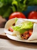 Burritos with beef tomato and salad leaf — Stockfoto
