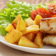 Stock Photo: Roasted codfish fillet with vegetables