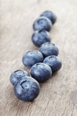 Ripe blueberries on wooden table — Zdjęcie stockowe