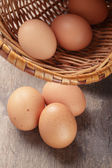 Speckled chicken eggs on old table — Stock Photo