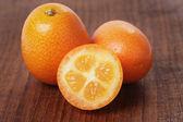 Fresh kumquat on wood table — Stock Photo
