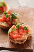 Simple italian appetizing bruschetta with tomato — Stock Photo