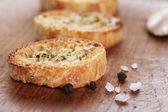 Crostini with olive oil and garlic — Stockfoto