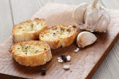 Crostini with olive oil and garlic — Stock Photo