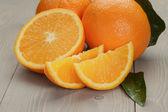 Ripe oranges on wooden table — Foto de Stock
