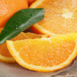Ripe oranges on wooden table — Stock Photo #44411525