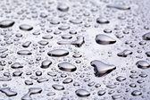 Abstact acqua cade sulla superficie in acciaio inox poniched — Foto Stock