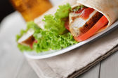 Freshly made tortilla wraps with chicken and vegetables — Stock Photo