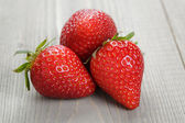 Ripe strawberries on wood table — Stock Photo