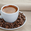 Cup of fresh espresso with beans — Stock Photo #49422171