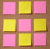Sticky notes on cork board — Stock Photo