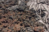 Transition from smooth pahoehoe to rubbly aa lava — Stock Photo