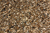 Mixture of coral sand and weathered volcanic rocks in Oahu — Stock Photo