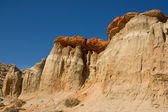 Siltstone cliff covered with a layer of sandstone — Stok fotoğraf