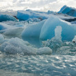 Melting icebergs calved off from a glacier in Iceland — Stockfoto