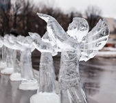 Carved sculpture of frozen angel in ice — Stock Photo