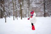 Adorable preschooler girl in beautiful winter park — Stock Photo