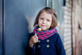 Portrait of preschooler girl with lollypop — Stockfoto