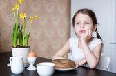 Nice preschooler girl with breakfast — Stock Photo