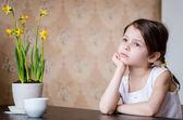 Thoughtful preschooler girl in the kitchen — Stok fotoğraf