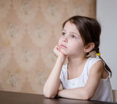 Thoughtful adorable preschooler girl — Stock fotografie