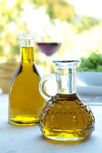 Olive oil on the table with natural background — Stock Photo