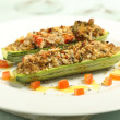 Stuffed zucchini gratin on white plate — Stock Photo