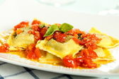 Italian ravioli with tomato and spices — Stock Photo