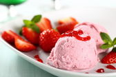 Strawberry ice cream with fruit and mint on white dish — Stock Photo
