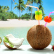 Fruit cocktails coconut  on the beach — Stock Photo
