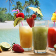 Colorfull cocktails with fruit on the beach — Stock Photo