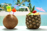 Fruit cocktails coconut and pineapple on the beach — Stock Photo
