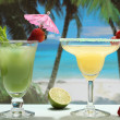Alcoholic cocktails with fruit on the beach — Stock Photo