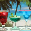 Alcoholic cocktails on the beach - Stock Photo