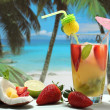 Summer cocktail with fruit on the beach — Stock Photo