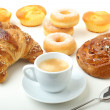 Breakfast with coffee croissant and donuts on white background — Stock Photo