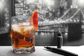 Cocktail on black and white background — Stock Photo