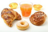 Croissant donuts and orange juice on white background — Stock Photo