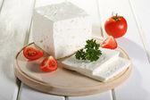 Cheese feta on black stone — Stock Photo