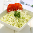 Cabbage salad on ceramic bowl — Stock Photo #28564321