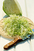 Cabbage salad on cutting board — Stock Photo