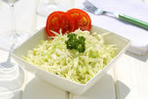 Cabbage salad on ceramic bowl — Stok fotoğraf