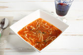 Tomato soup with pasta on white ceramic bowl — Stock Photo