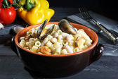 Pasta with beans and mussels dark background — Stock Photo