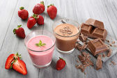 Strawberry and chocolate shake gray background — Stock Photo